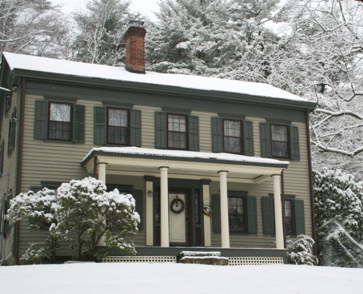 Federal style house in snow